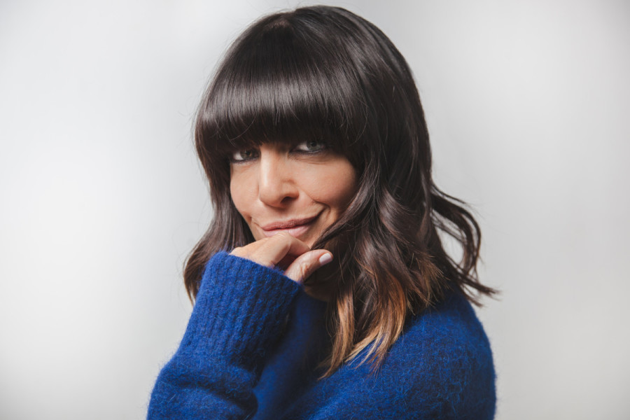 An influencer Claudia Winkelman looking at the camera and smiling.