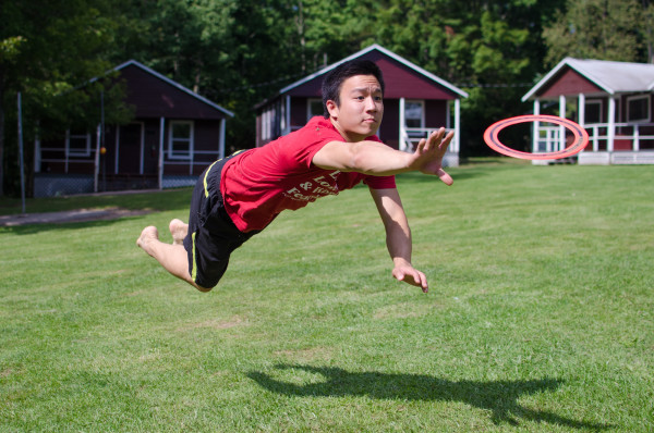 catching a frisbee at summer camp