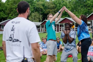 Team members playing a game at camp