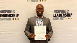 alt text Director of Diversity, Equity, and Inclusion posing for a photo while attending Hispanic Leadership Summit
