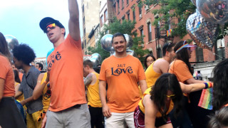 alt text CEO in a crowd of Justworks employees at pride
