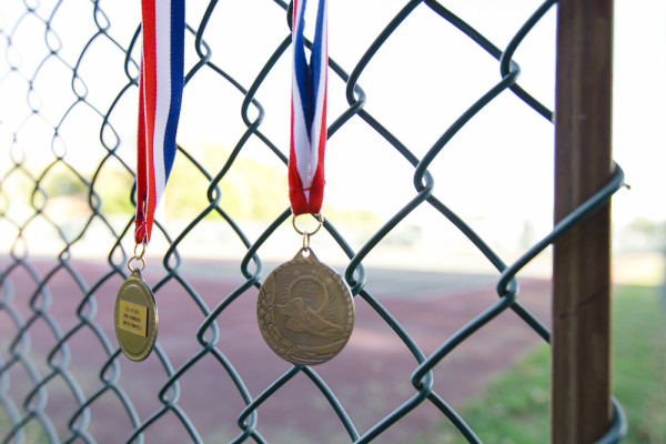 medals hanging on a fence