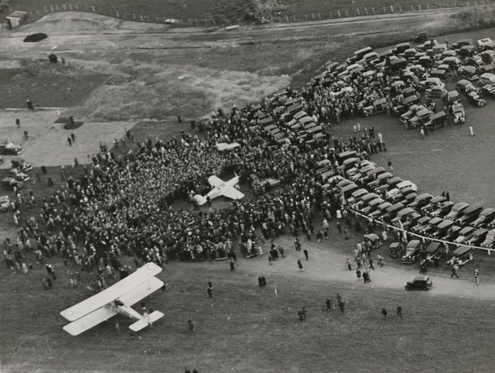 Jean Batten arrives to a large crowd at Mangere, Auckland after her solo flight from England to New Zealand in 1936.