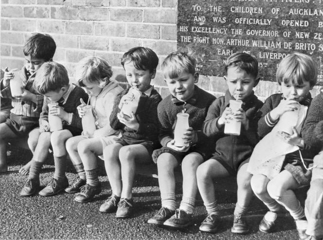 School children drinking free milk
