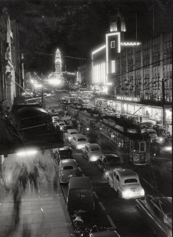 Graham Stewart. Queen Street lit up for the visit of Queen Elizabeth, Christmas 1953. Auckland Trams, 08/092/401. Walsh Memorial Library, The Museum of Transport and Technology (MOTAT).