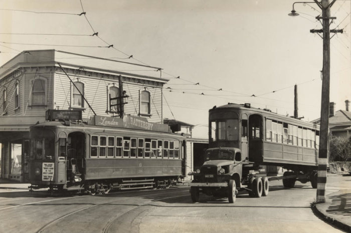 Photographer Graham Stewart captures Tram no. 218 and retired tram no. 224 on the corner of Manukau Road and Trafalgar Street. 1956. PHO-2017-5.31. Walsh Memorial Library, The Museum of Transport and Technology (MOTAT).