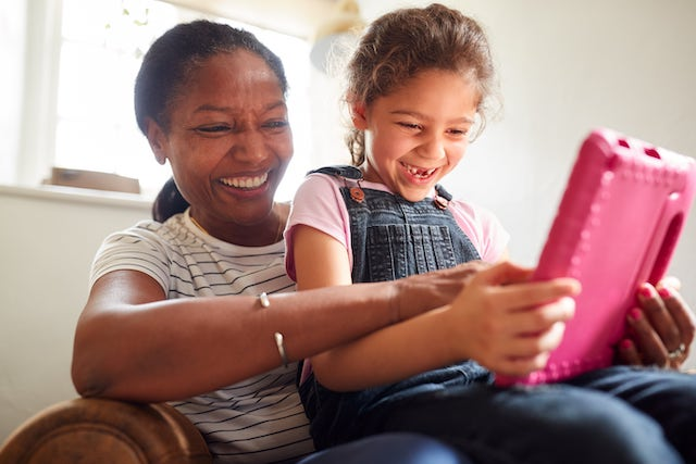 mother and child playing a math app on their tablet