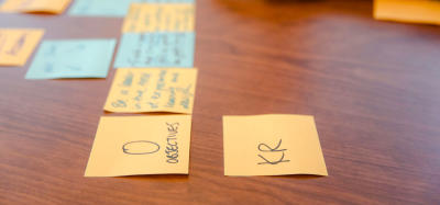 okrs, sticky notes on desk
