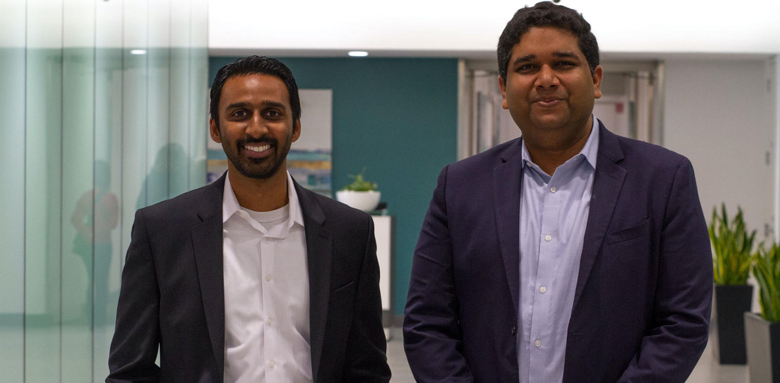 two men standing in an office hallway, Dr. Vivek Garg, CareMore's Chief Medical Officer, caremore health