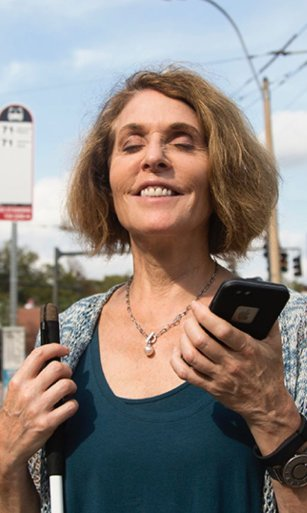 A visually impaired woman uses VoiceOver to navigate the BlindWays app.