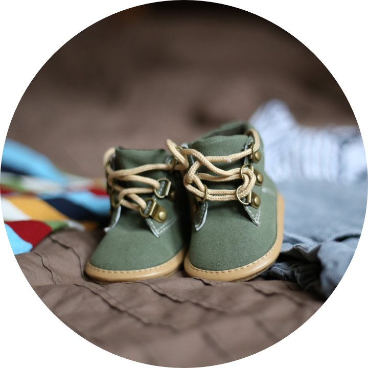 2 tiny green baby shoes.