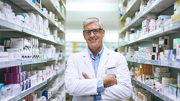 pharmacist standing in pharmacy