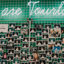 Employee photowall in Tourlane's headquarters.