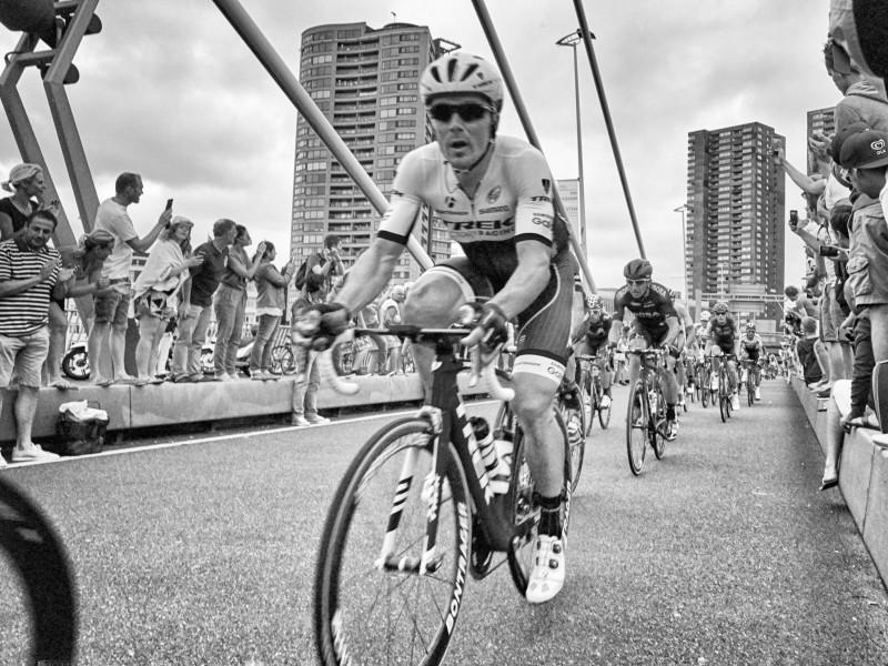 Black and White Photo of cyclist in Tour de France peleton crossing bridge in Rotterdam.