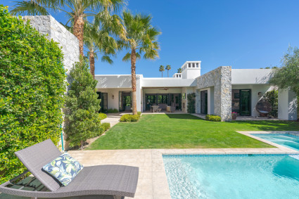 Palm Springs backyard with pool, grass, and outdoor seating