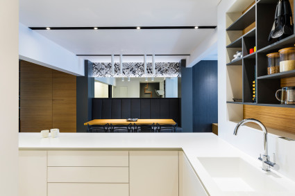 Bright kitchen overlooking dark dining room