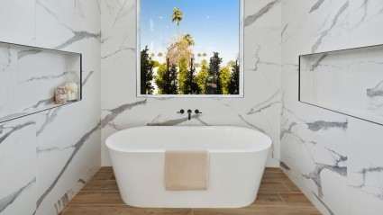 Marble walls with whit tub and window