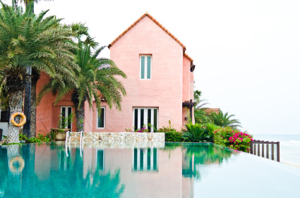 pink house with infinity pool