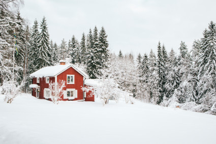 Red wood cabin in snow