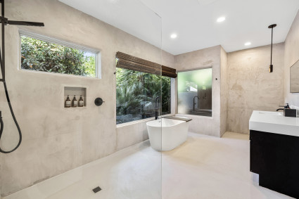 Oasis Bathroom with shower and tub