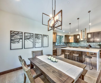 cabin inspired kitchen and dining area with modern fixtures