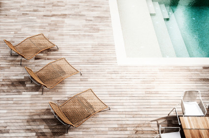 aerial shot of chairs by pool steps