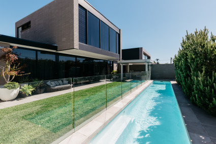 modern home with grass and pool