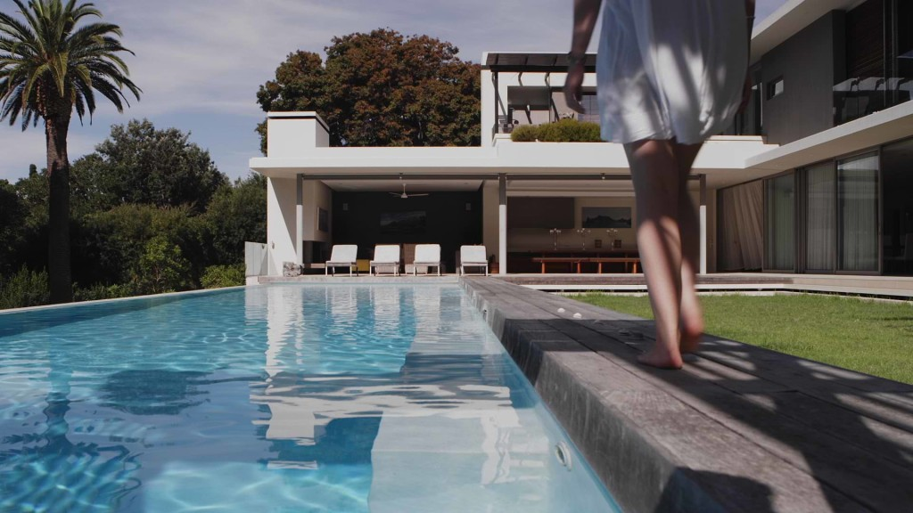 thumbnail for brand video - woman walking by pool