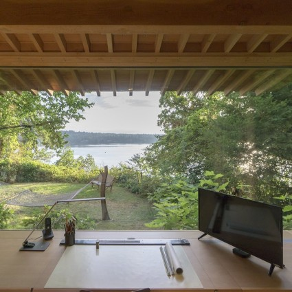 Office overlooking lake and trees