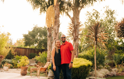 Kirk and Sheray standing under a palm tree