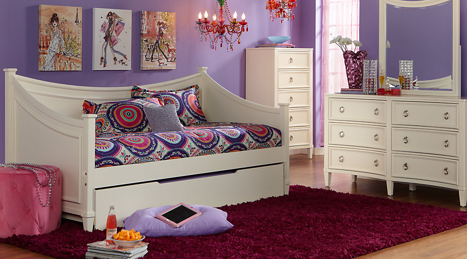 White Daybed Set Accented by Purple and Red Decor