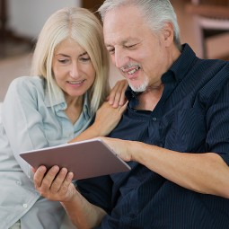 A couple looking at the tablet