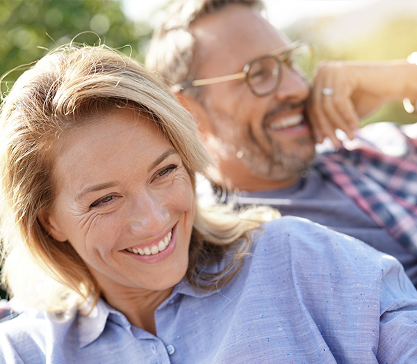 Two people laughing outdoors