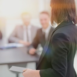 A female presenting in the conference room