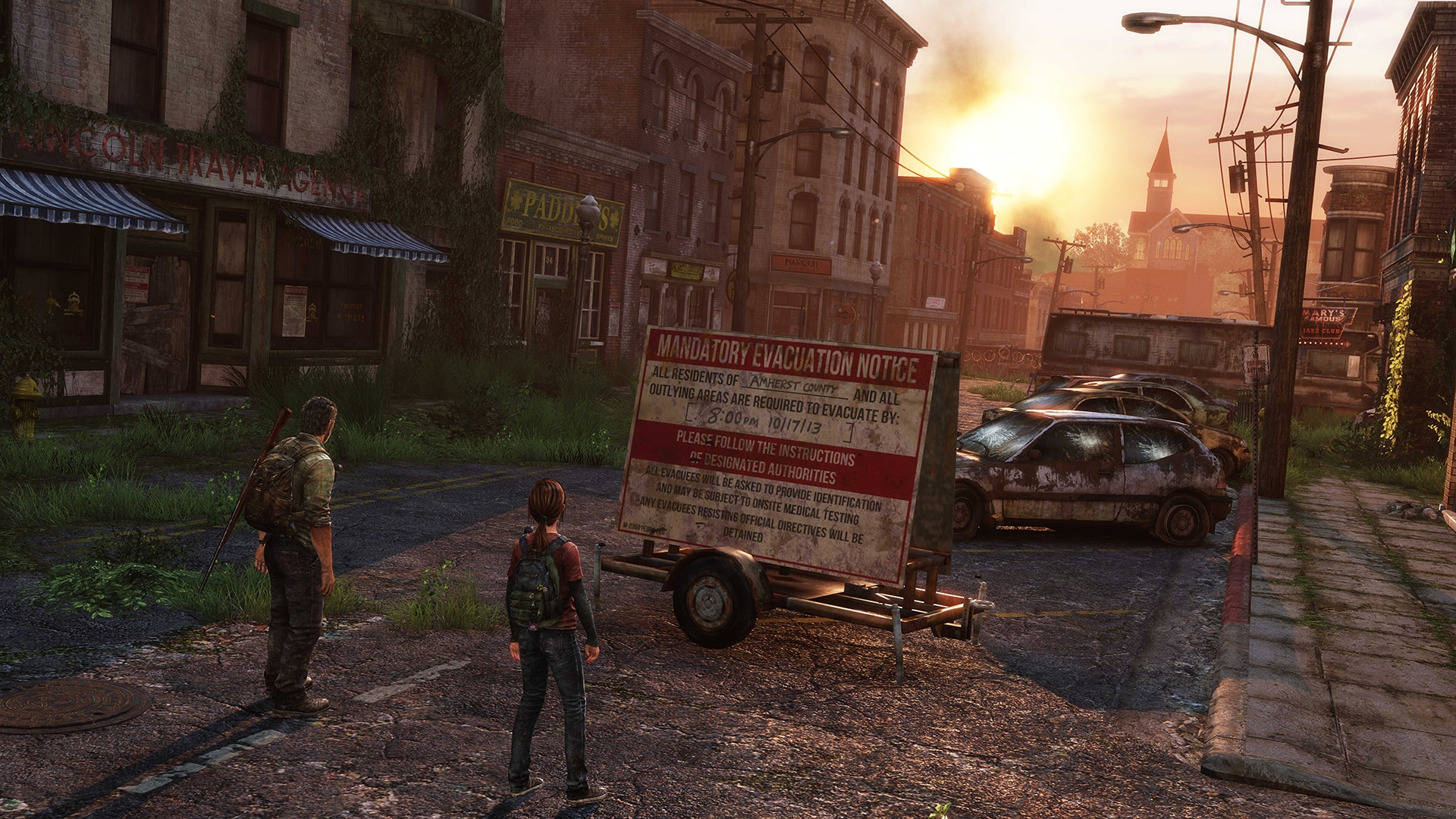 Joel i Ellie na screenie z gry The Last of Us w scenerii zniszczonego miasteczka