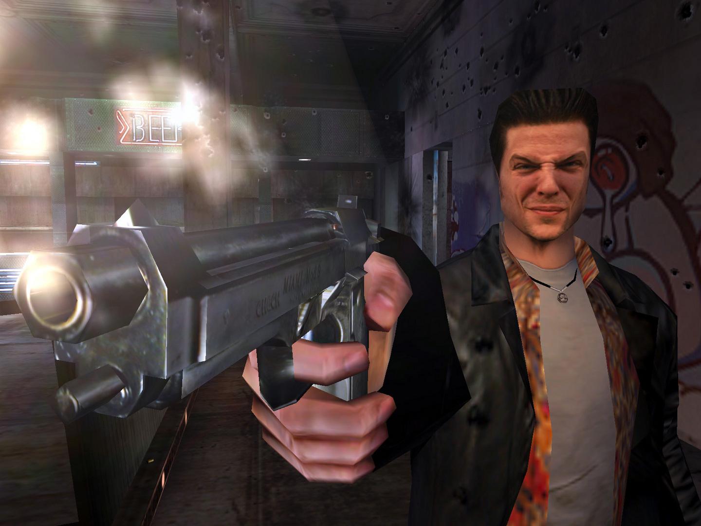 Max Payne z wycelowaną w ekran bronią.
