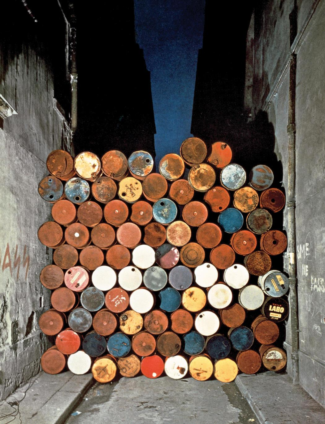 Christo   jeanne claude  wall of oil barrels     the iron curtain  rue visconti  paris  1961 62
