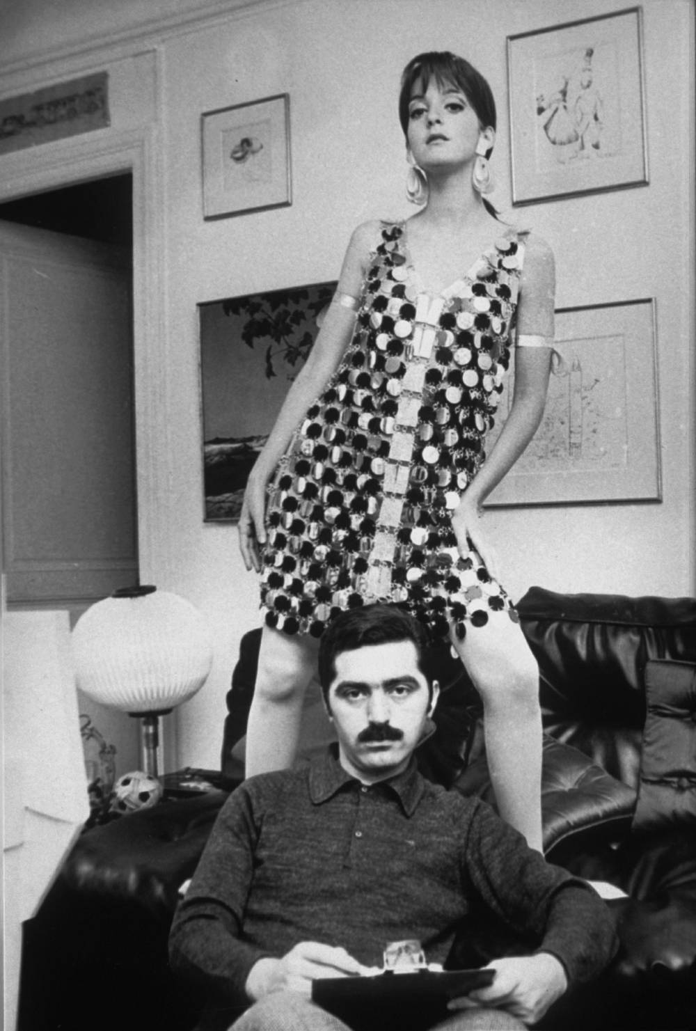 Portrait , Paco Rabanne with a model in one of his link dresses, 1966