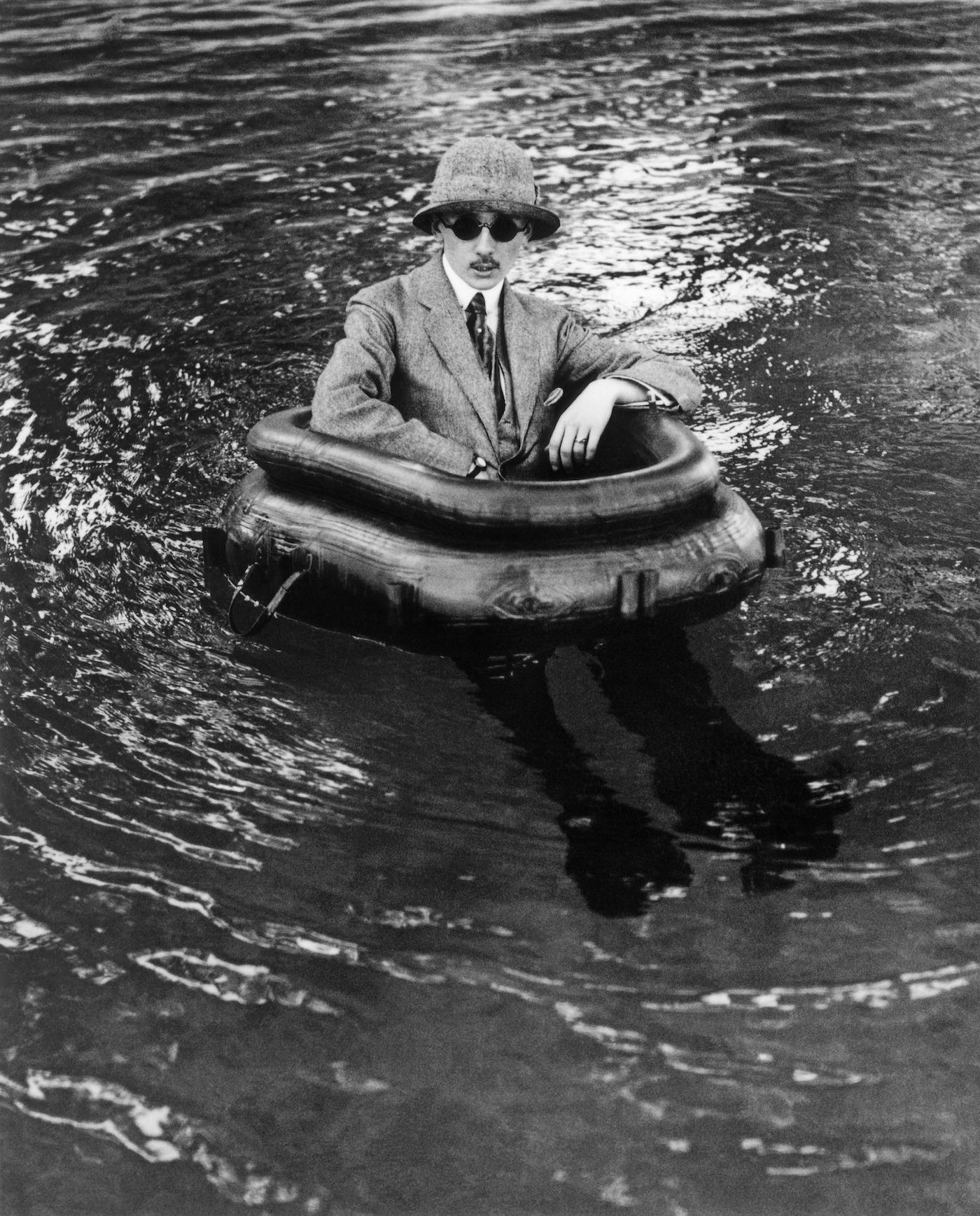 Henri lartigue  zissou in his tire boat by jacques  1911