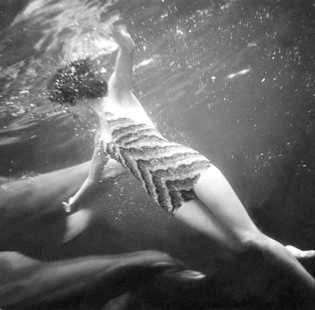 Model in bathing suit by best  swims with dolphins  photo by toni frissell  florida  1938