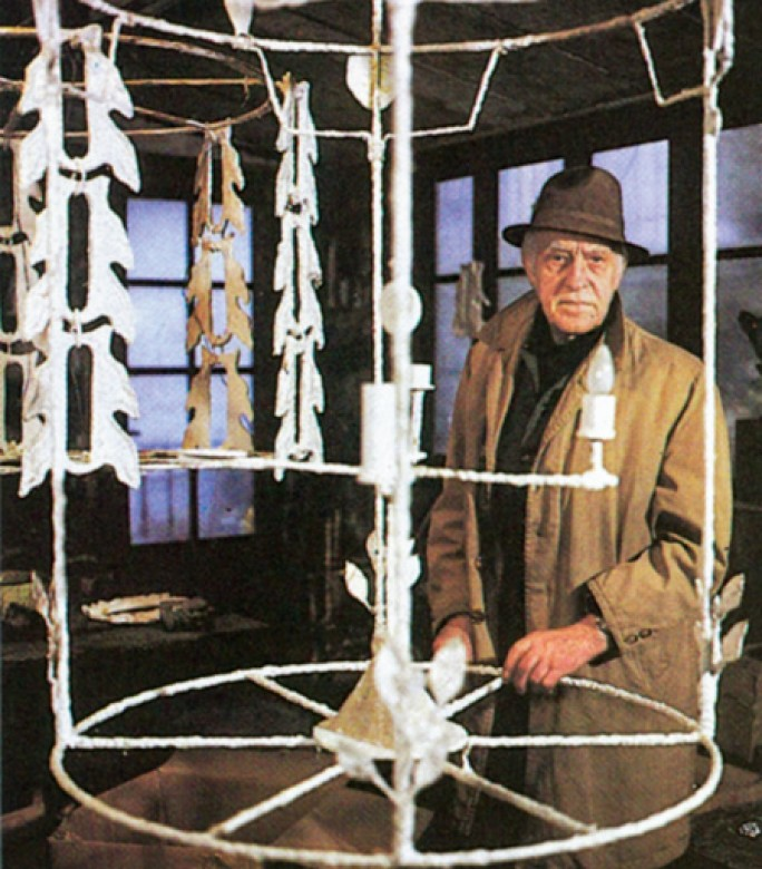 Diego giacometti in his studio working on teh chandelier for the picasso museum