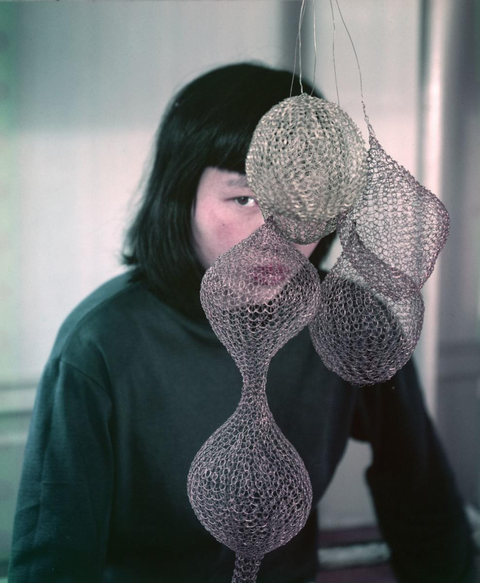 A photograph of ruth asawa and her art taken by her close friend imogen cunningham circa 1957