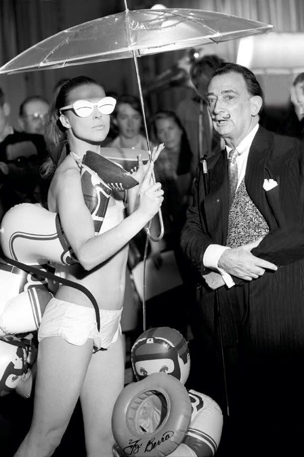 Salvador Dalí , With model wearing his swimwear design, 1965