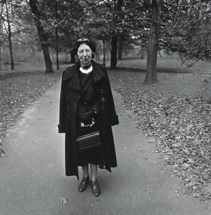 Woman in long coat and dark hat  central park  n.y.c. 1962. photo  diane arbus copyright