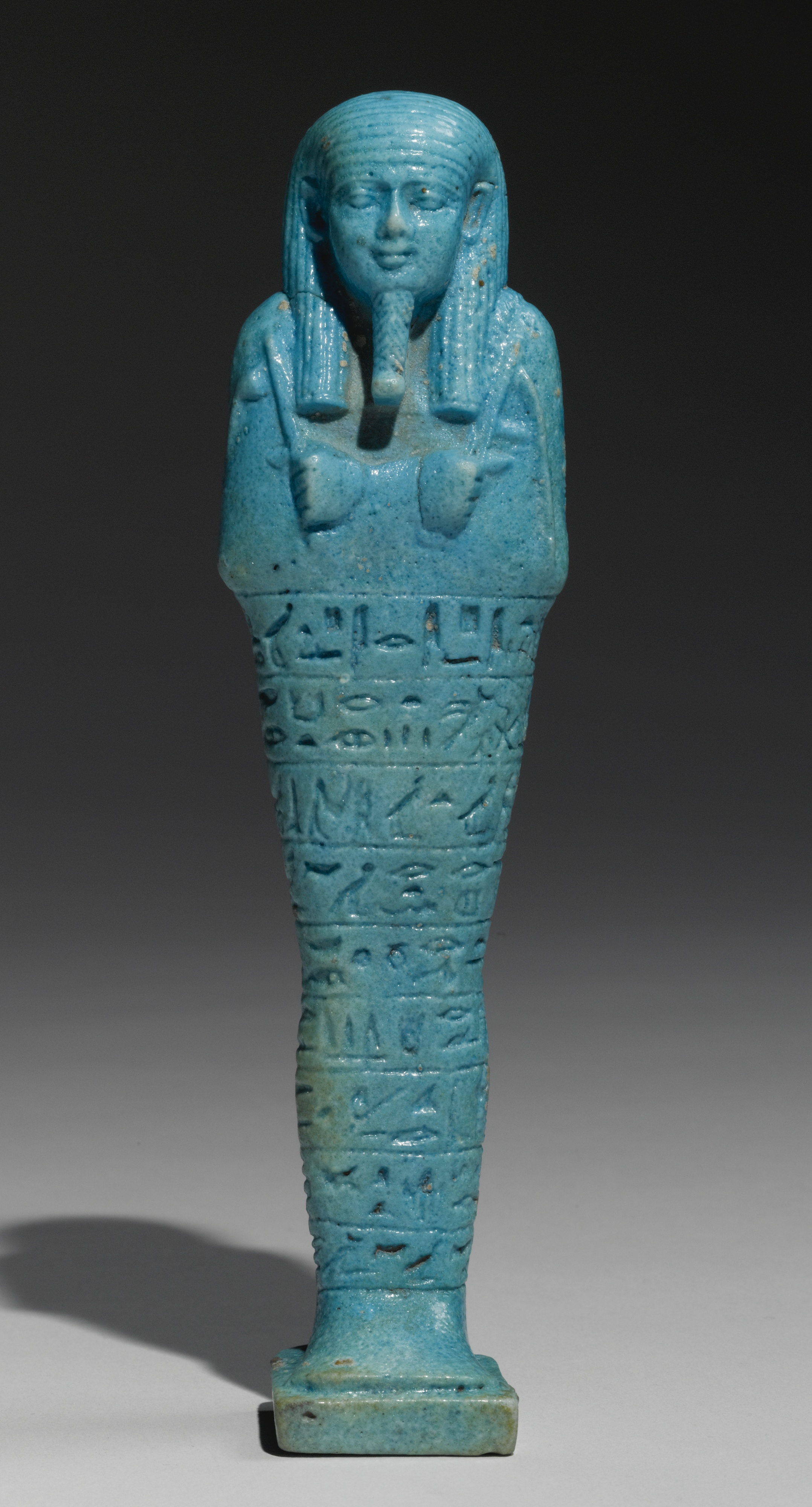 An egyptian bright blue faience ushabti of psamtik  god s father  born to seba rekhyet  570 526 b.c