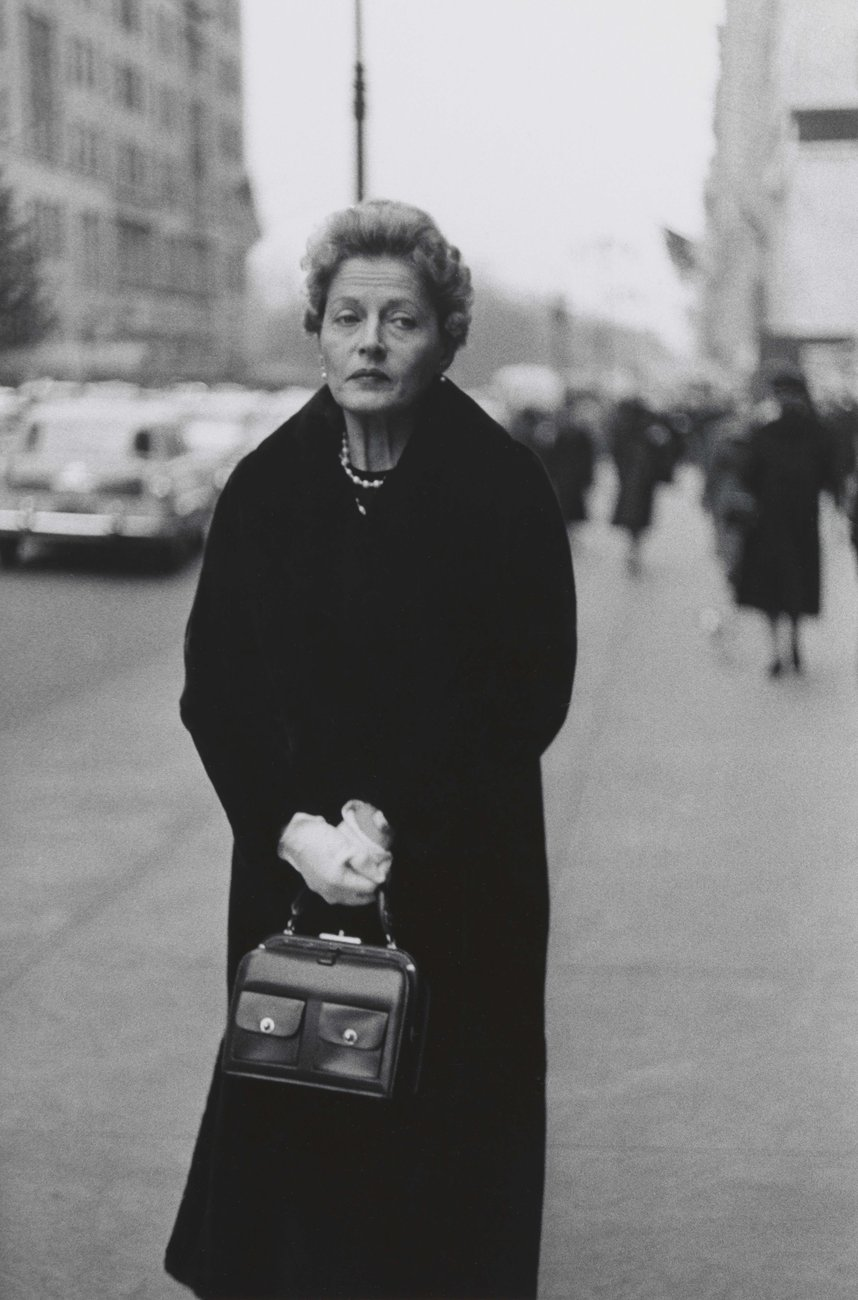 Woman with white gloves and a packet book  nyc  1956