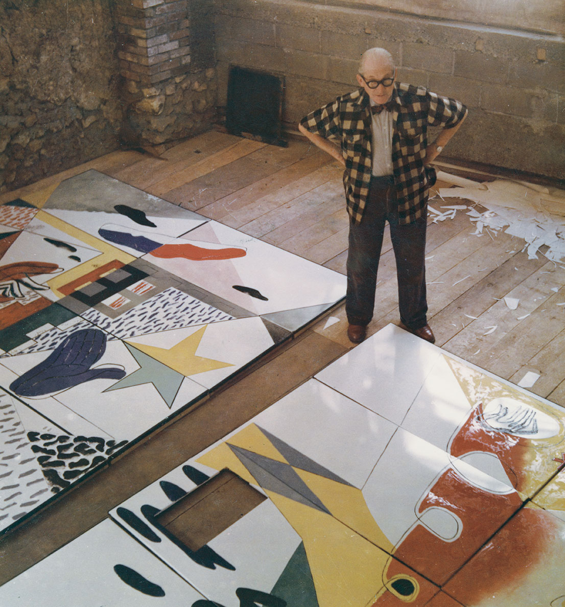 Le corbusier with enamelled door panels for notre dame du haut in ronchamp  france  1955