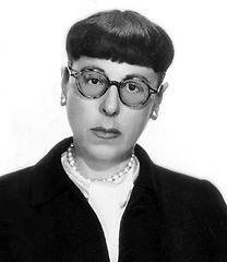 Edith head  pictured in her famous eyeglasses  1955