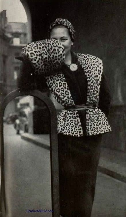 Model wearing an ensemble with leopard skin by pierre balmain  1950.