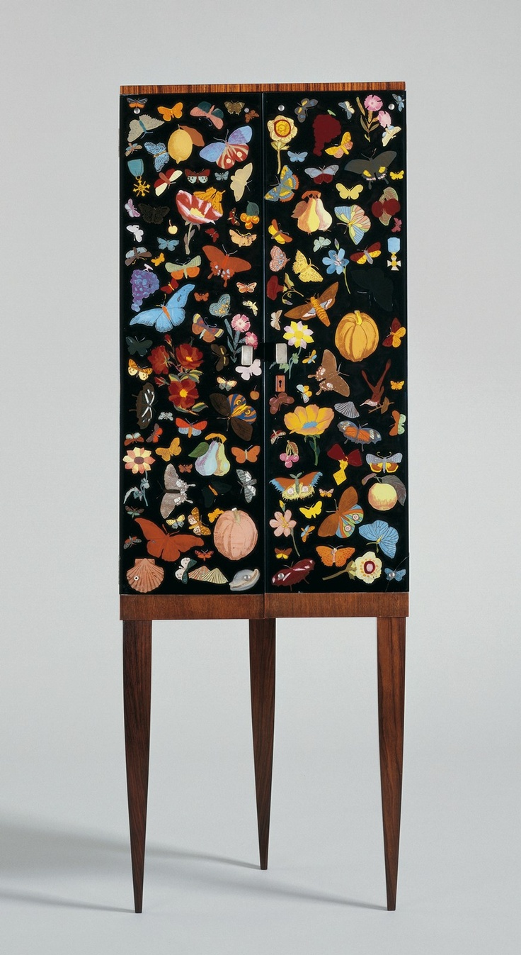 Corner cabinet with reverse painted glass doors by piero fornasetti and gio ponti  1941